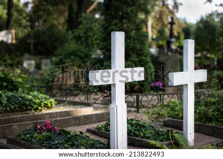 White crosses at old cemetery. Selective focus. - stock photo