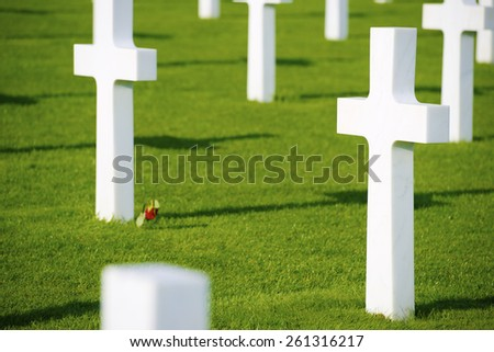 White crosses in American Cemetery, Coleville-sur-Mer, Omaha Beach, Normandy, France. - stock photo