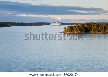 white cruise liner in Baltic sea at sunset - stock photo