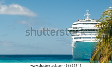 white cruise ship and palm tree - stock photo