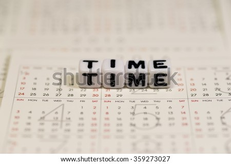 White cube blocks with the text, TIME, on Calendar - stock photo