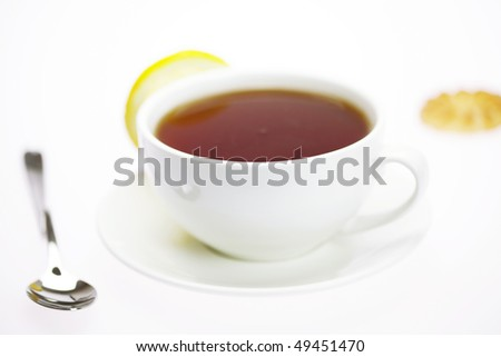 white cup and lemon isolated on white - stock photo