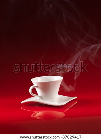white cup and saucer with hot coffee, on red background - stock photo