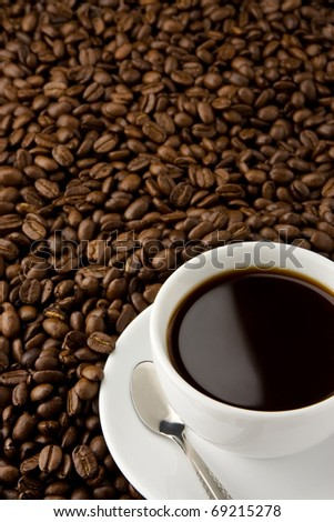 white cup of coffee and beans - stock photo