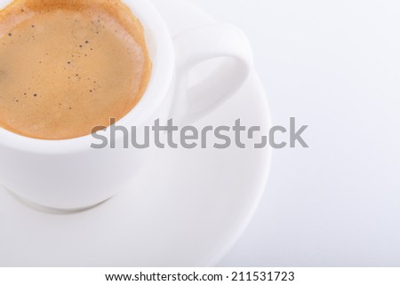 White cup of coffee on white background - stock photo