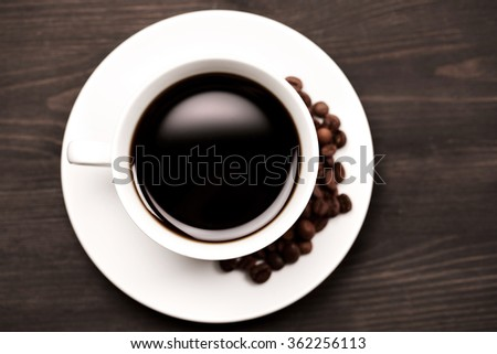 White cup of coffee, top view - stock photo