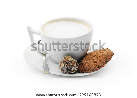white cup of coffee with chocolate candy, cookies and teaspoon on the white plate on a white background isolated  - stock photo