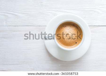 White cup of espresso coffee on background - stock photo