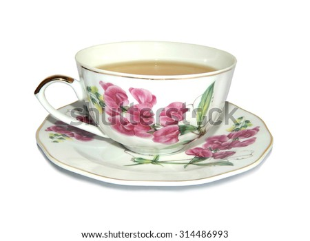 White cup of green tea and saucer with a picture of pink flowers, on white background - stock photo