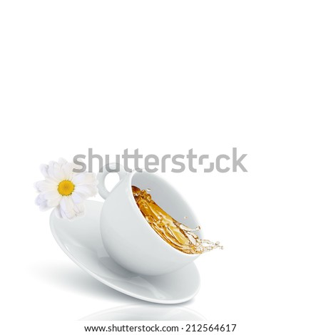 White cup of tea with chamomile flower - stock photo