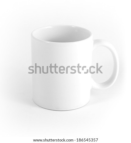 White cup on gray background - stock photo