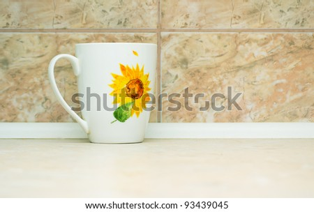 white cup on the background of marble tiles - stock photo