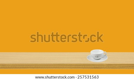 White cup on the shelf with a colored background space for text   - stock photo
