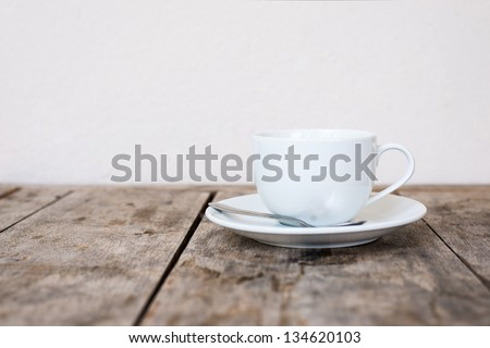 White cup on wood table. - stock photo