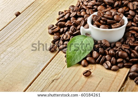 white cup with coffee beans - stock photo
