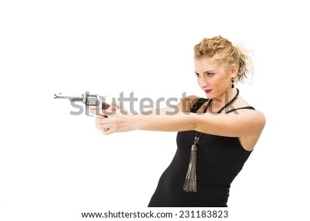 White Curly Blonde Female in Black Dress holding a gun / Pistol / Handgun pointing landscape - stock photo
