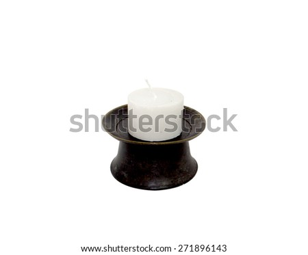White cylindrical candle on the black forged metal stand, isolat - stock photo