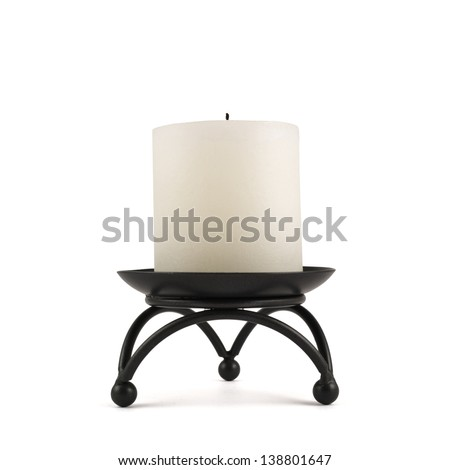 White cylindrical candle on the black forged metal stand, isolated over white background - stock photo