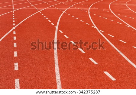white dash line on red running track on natural light - stock photo