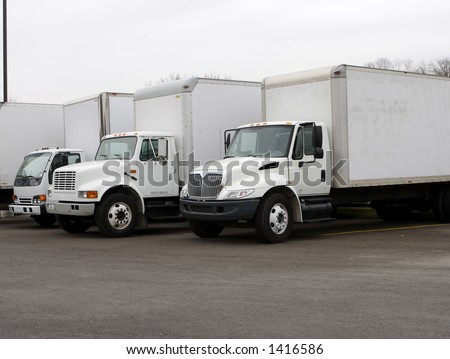 White Delivery Trucks - stock photo