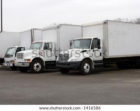 White Delivery Trucks - stock photo