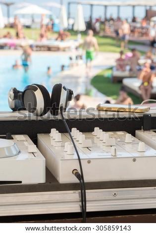 White Dj mixer on a swimming pool party - stock photo