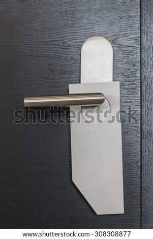 White door hanger without text on modern black door - stock photo