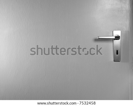 white door with metal door handle - stock photo