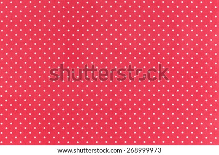 White dots over red Polka dot fabric background and texture - stock photo