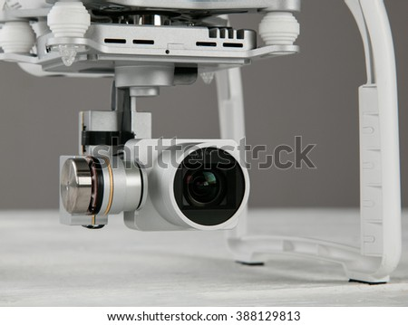 White drone. Quadrocopter with photo camera, close-up. - stock photo