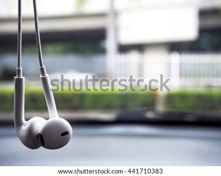 White earphones in park background  - stock photo