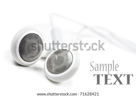 White earphones on a white background with space for text - stock photo