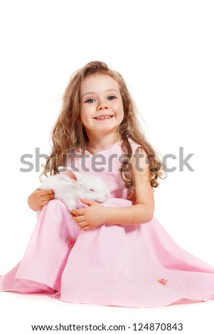 White Easter bunny and beautiful smiling girl - stock photo