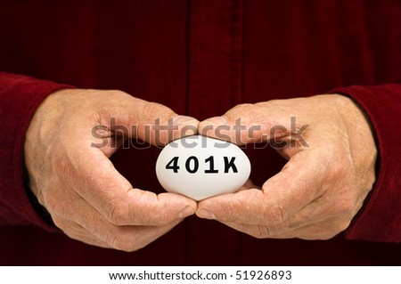 White egg with 401k written on it with black letters. Held by a man in a red shirt. - stock photo