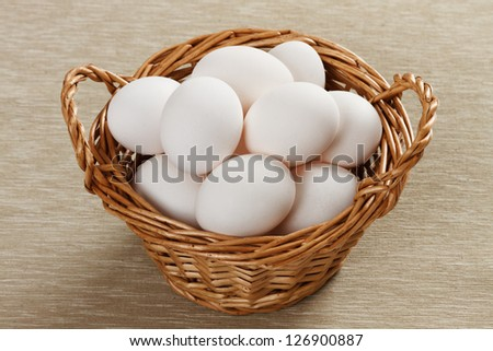 White eggs in basket - stock photo