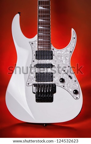 white electric guitar on fiery background - stock photo