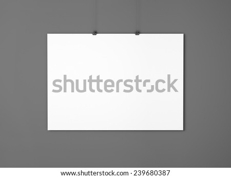 White empty paper with clips on the black wall - stock photo