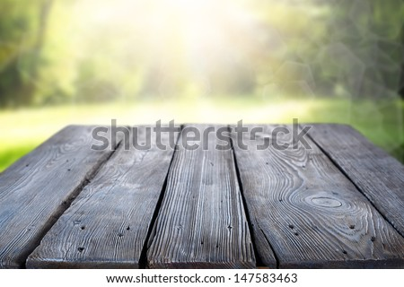 white empty table in garden  - stock photo