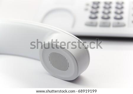 White enterprise desktop phone - stock photo