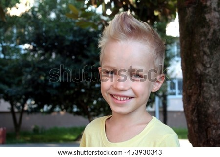 White european young boy smiling and looking directly at the camera - stock photo