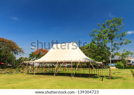 white events tent in the field. - stock photo