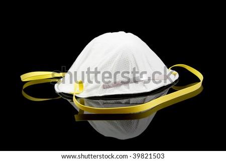 White face mask isolated on black background - stock photo