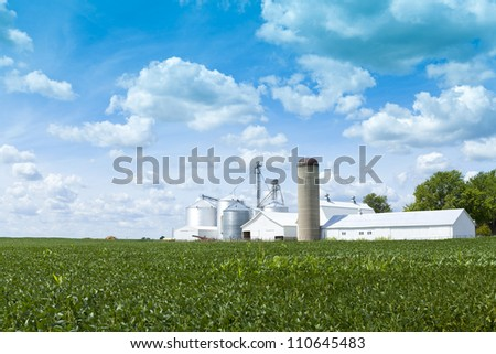 White Farm With Cloudy Sky - stock photo