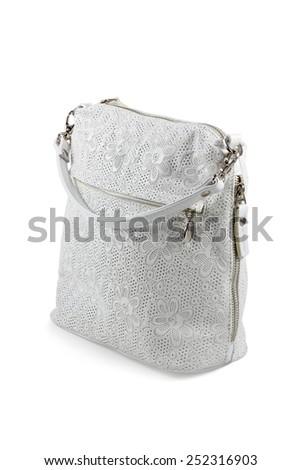White Fashionable ladies handbag with zipper isolated on a white background - stock photo