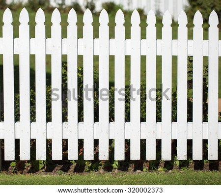 white fence and front yard - stock photo
