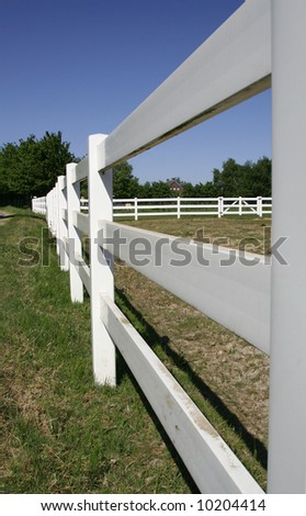 White fence of a ranch on the countryside in the Netherlands. - stock photo