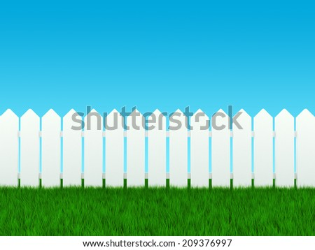 White fence on grass and blue sky - stock photo