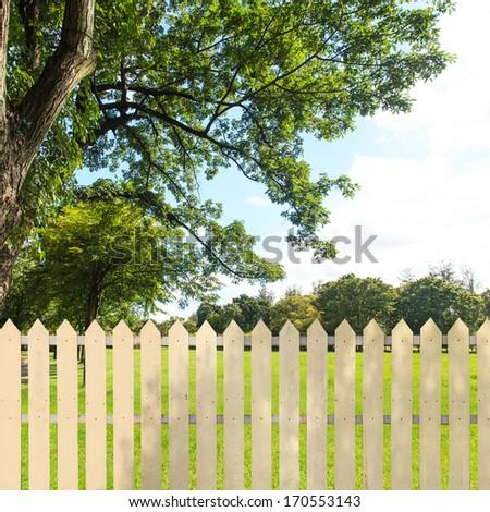 White fences in the garden - stock photo