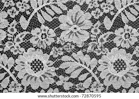 White fine lace floral texture on black background - stock photo