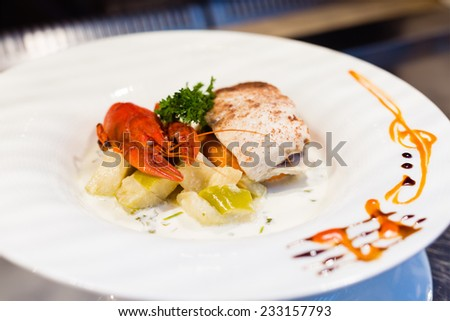 White fish with cinnamon on a display in an open buffet restaurant. Shallow depth of field - stock photo